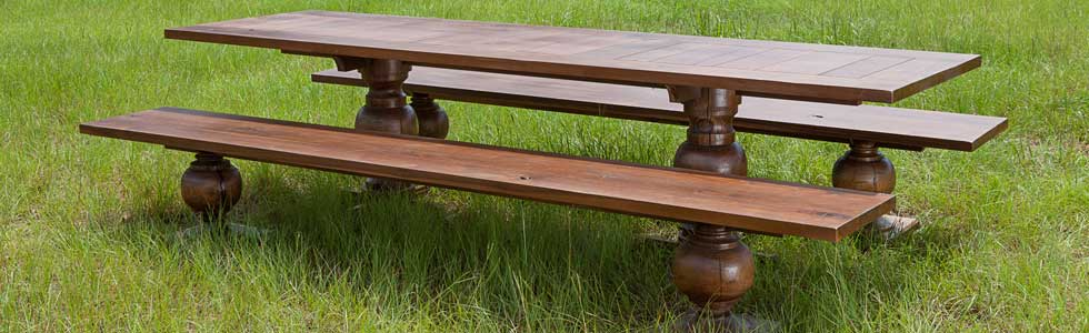 Walnut Table and bench seating. Made from antique walnut air dried lumber. Approximately 10 feet long by 30 inches deep. Columns turned from a single piece of walnut. Designed by Harley Ashbaugh of AWD of Savannah. Photographed by Angela Hopper-Lee.